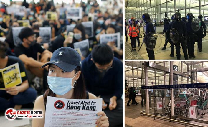 Hong Kong'da protestolar sürüyor: Polisten işgalin sürdüğü havalimanına 'ziyaret'