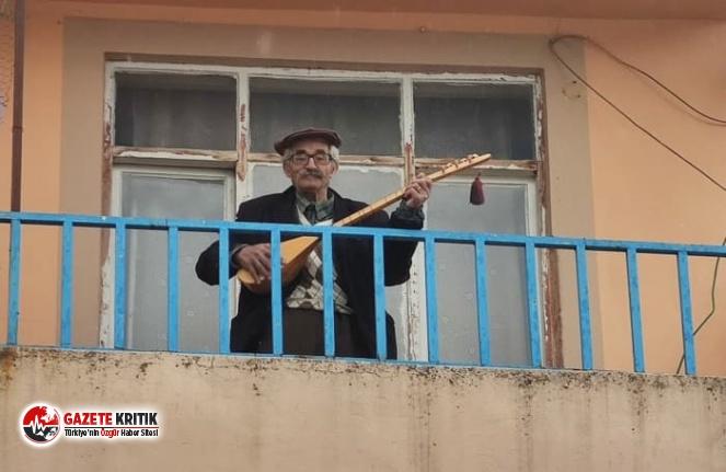 Tunceli'de 96 yaşındaki dede curasını aldı, balkondan 'Evde Kalın' mesajı verdi