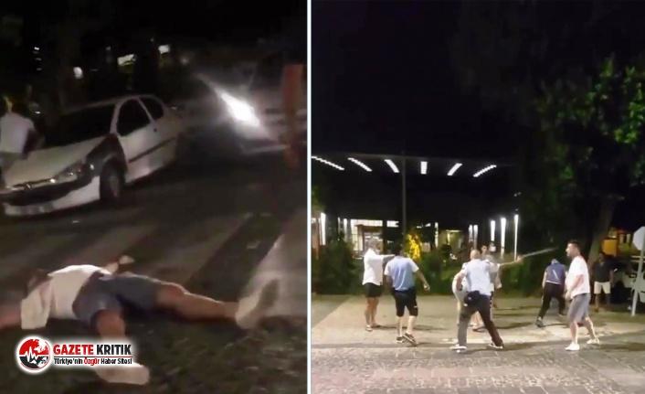 Otomobil çarpan arkadaşlarına rağmen kavgaya devam ettiler